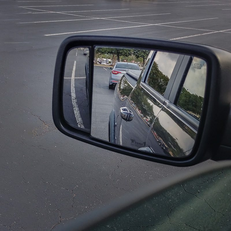 demonstrate easier parking with RAM spotter mirror